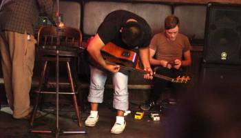 A 25-year-old college student tunes his guitar at the Crystal Pistol before playing a show in downtown Tulsa, Okla., on July 11, 2011. He came to the U.S. illegally with his mother at age 14 from Mexico to join his father. He graduated from a Tulsa High School and is close to finishing two TCC degrees, but cannot get a job because of his status.
