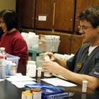 Alexis Chen and Jathan Coburn prepare free prescriptions.