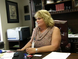 Donna Dyer runs the East Central Oklahoma Family Health Center in Wetumka, where about half of the patient population is uninsured.