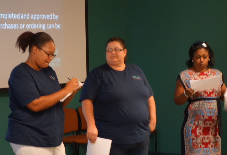 Renea Al-Batati (center) participates in a Gear Up group activity in Oklahoma City. Al-Batati, whose son attends Southeast High School, helps an effort to increase attendance at parent-teacher conferences at the school.