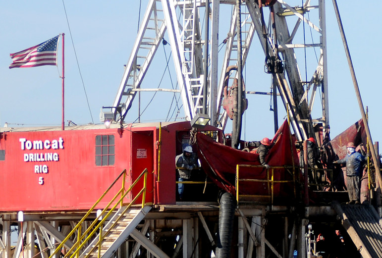 Tax breaks for energy companies have soared since 2010. In this photo, despite freezing temperatures Thursday, members of the Tomcat Drilling Rig 5 crew continued their quest for oil next to U.S. 81 north of Enid.