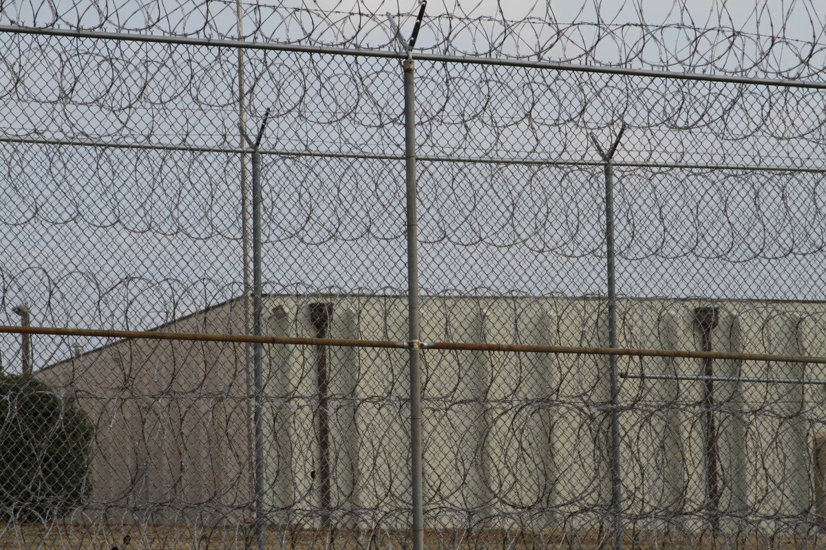 A razor wire fence surrounds the Joseph A. Harp Correctional Center in Lexington.