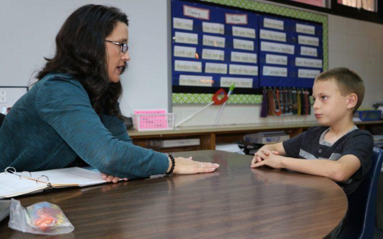 Special education teacher Renee McFarland works with student Wyatt Triplett, 7, in her classroom at Pratt Elementary school in Sand Springs.