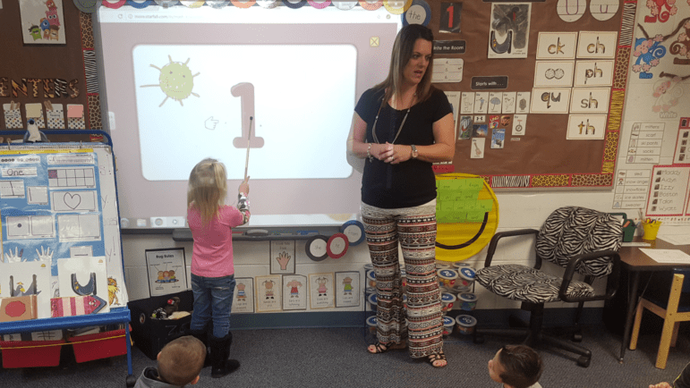 Stroud pre-K teacher Amber Miller teaches her class about numbers.