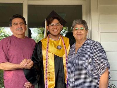 Ricardo Chavez and his parents.