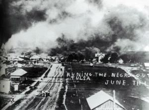 """""""Black Wall Street"""" is burnt down during the Tulsa Race Massacre. Image courtesy of Oklahoma Historical Society Research Division."""