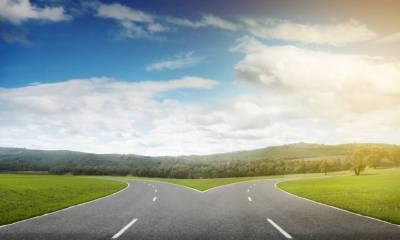 Natural landscape image of forked asphalt road