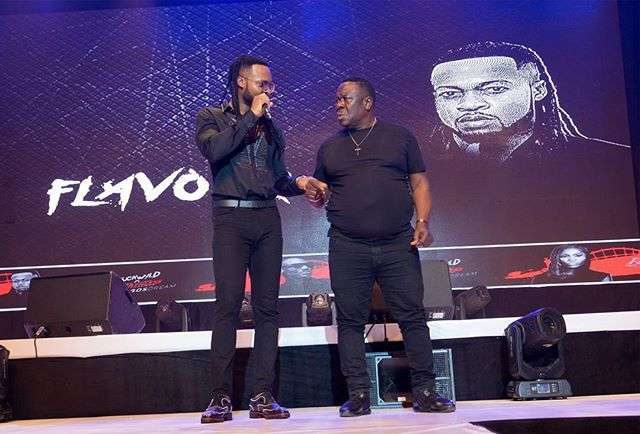 "Flavour and John 'Mr Ibu' Okafor performing at the Buckwyld and Breathless concert, ""The Lagos Dream."""