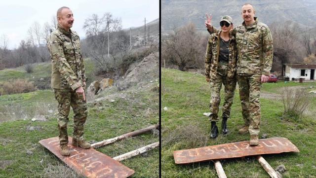 azerbaycan cumhurbaskani ilham aliyev ermenice tabelanin uzerine cikip zafer pozu verdi 0 JcxZKTMw - İlham Aliyev, Ermenice tabelanın üzerine çıkıp zafer pozu verdi