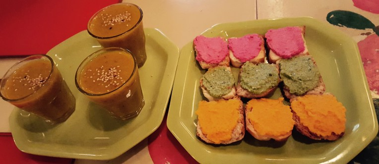 multicolored hummus with ginger juice apperitif