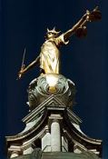 Themis and the scales of justice at night
