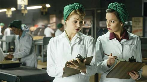 Ali Liebert as Betty and Jodi Balfour as Gladys in Bomb Girls: Facing the Enemy