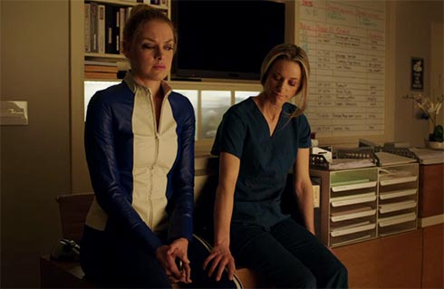 Lauren touches Tamsin's leg.