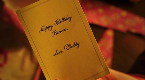 "A card that says ""Happy Birthday Princess. Love, Daddy"""