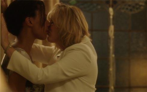 Kate and Caroline kissing.
