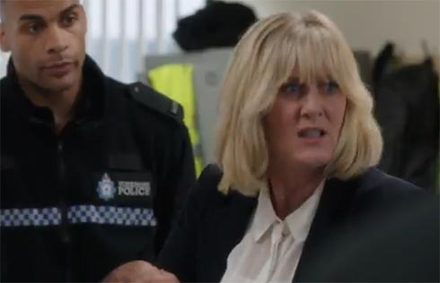Caroline finds Flora at the police station.