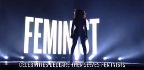 Beyonce in front of Feminist sign