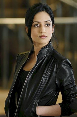 Kalinda in her leather jacket