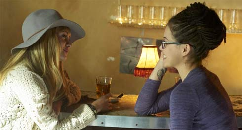 Shay and Cosima talk in the bar