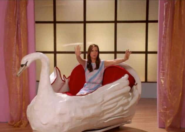 Kristen Wiig riding in a big swan