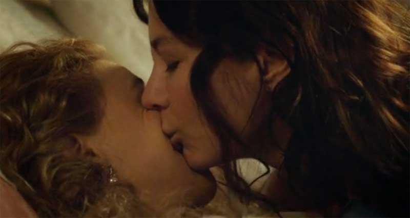 Malin Buska kisses Sarah Gadon on the cheek