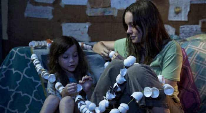 "Ma and Jack make egg shell chains in ""Room."""