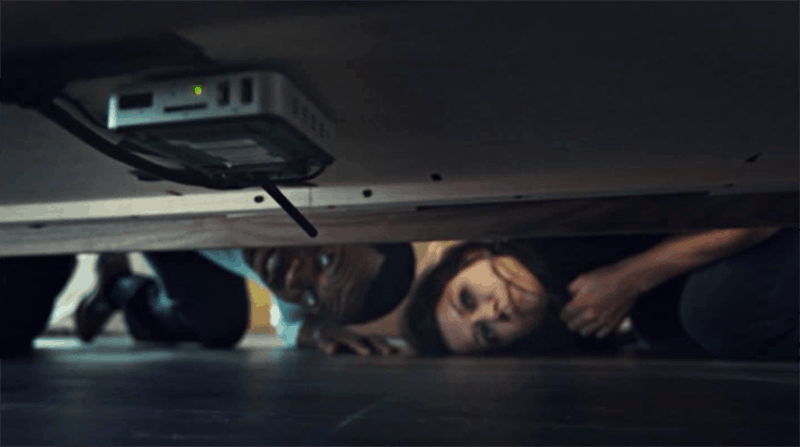 Kevin Hanchard and Tatiana Maslany in Orphan Black discover a hidden recording device
