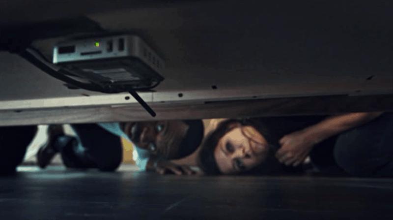Kevin Hanchard and Tatiana Maslany in Orphan Black discover a hidden recording device