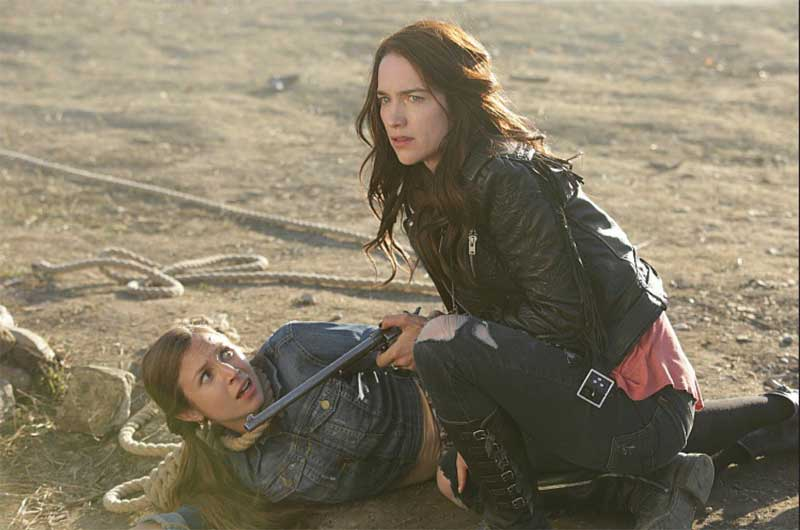 Dominique Provost-Chalkley and Melanie Scrofano in Wynonna Earp