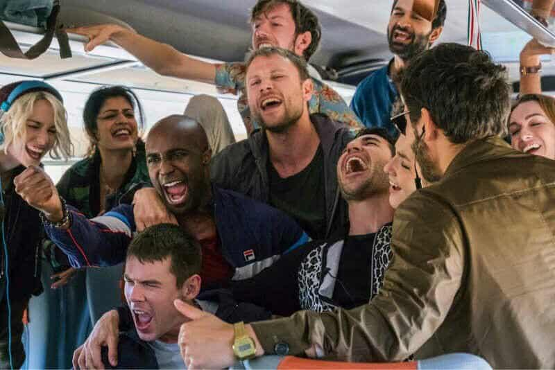 the cast of Sense8 in a group scene in a bus