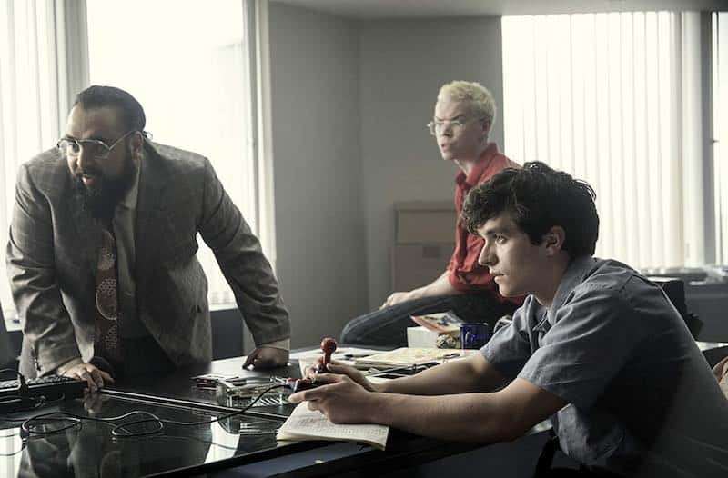 Will Poulter, Asim Chaudhry, and Fionn Whitehead in Black Mirror: Bandersnatch