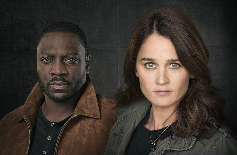 Robin Tunney and Adewale Akinnuoye-Agbaje in The Fix