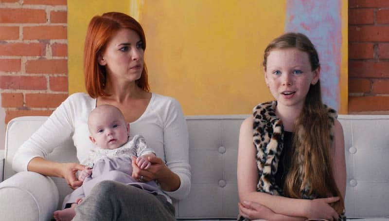 Dani Kind and Sadie Munroe in Workin' Moms