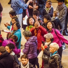 A group of Asian woman taking a selfie in the lobby of the Met