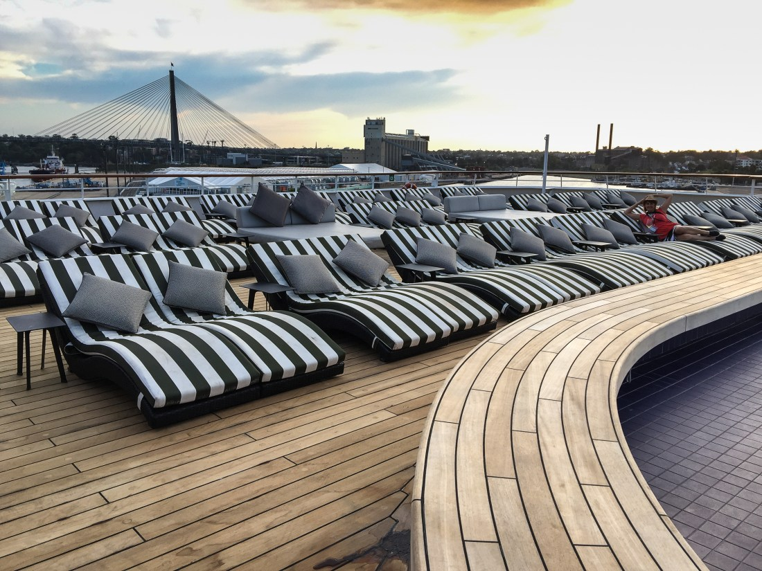 A row of deck chairs. I am lying on one of them