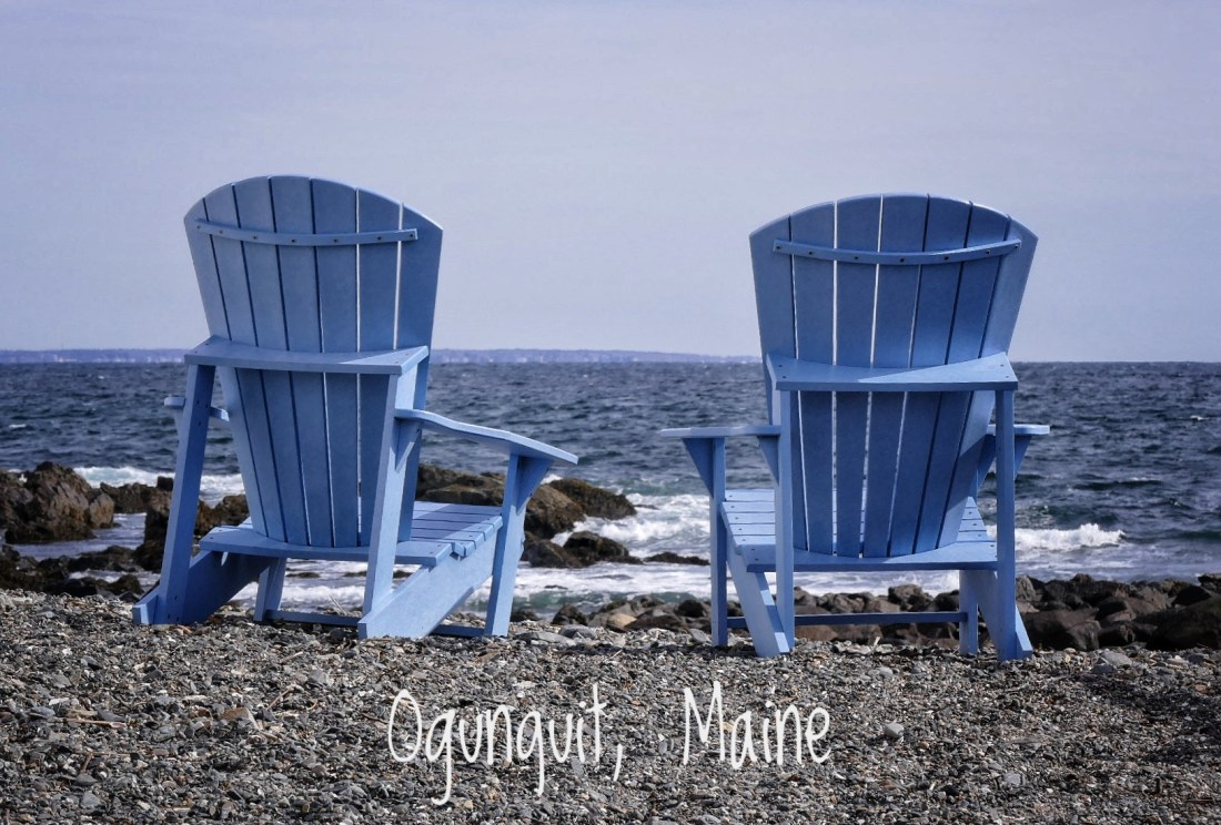 2 blue adirondack chairs near the ocean