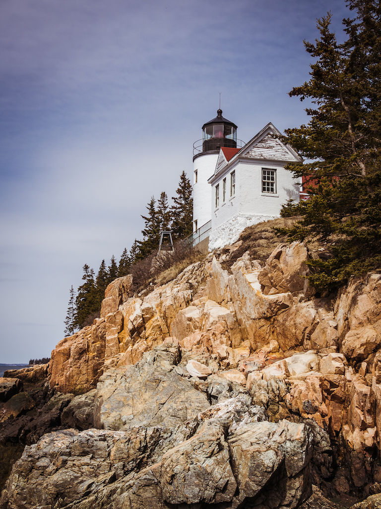 a small light house high up on a rocky ledge
