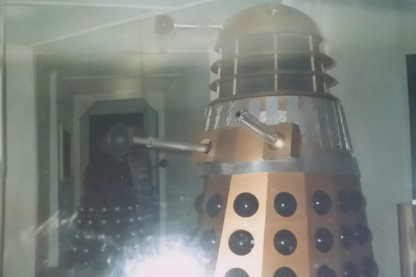 A gold Dalek with Davros in the back looking ominous. - Longleat exhibition 1989. Image Copyright - Dave Armitage.