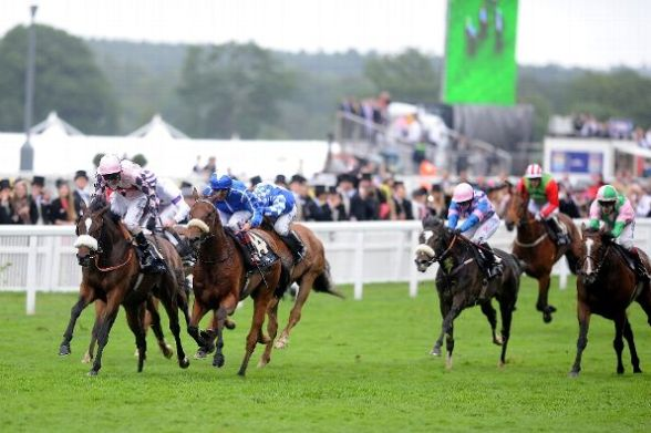 Jimmy Fortune riding Chiberta King (L) lands the Queen Alexandra Stakes during day five of Royal Ascot at Ascot Racecourse on June 22, 2013 in Ascot, England. (Photo by Charlie Crowhurst/Getty Images for Ascot Racecourse)