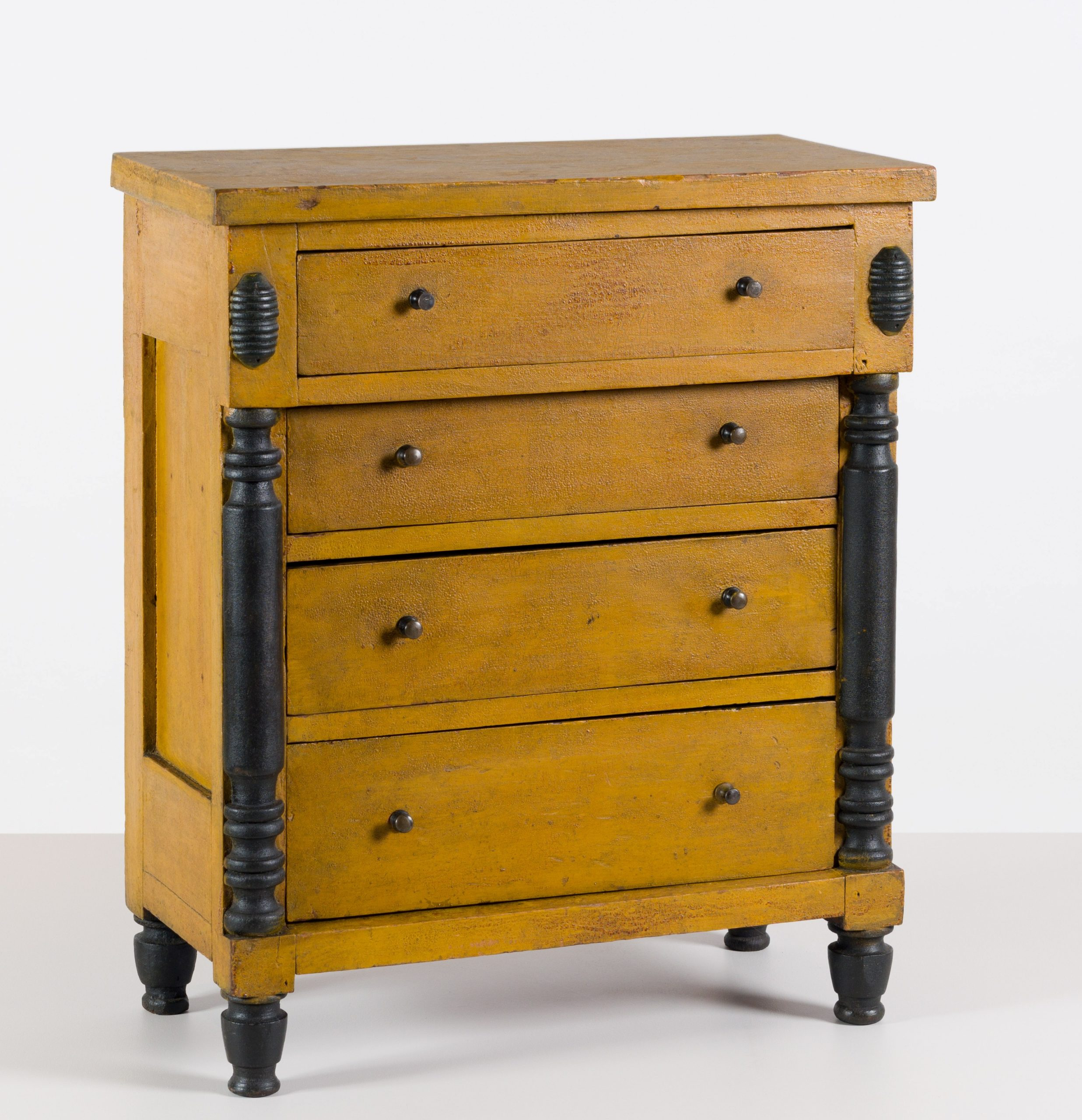miniature yellow four-drawer chest rel=