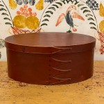 oval red shaker box