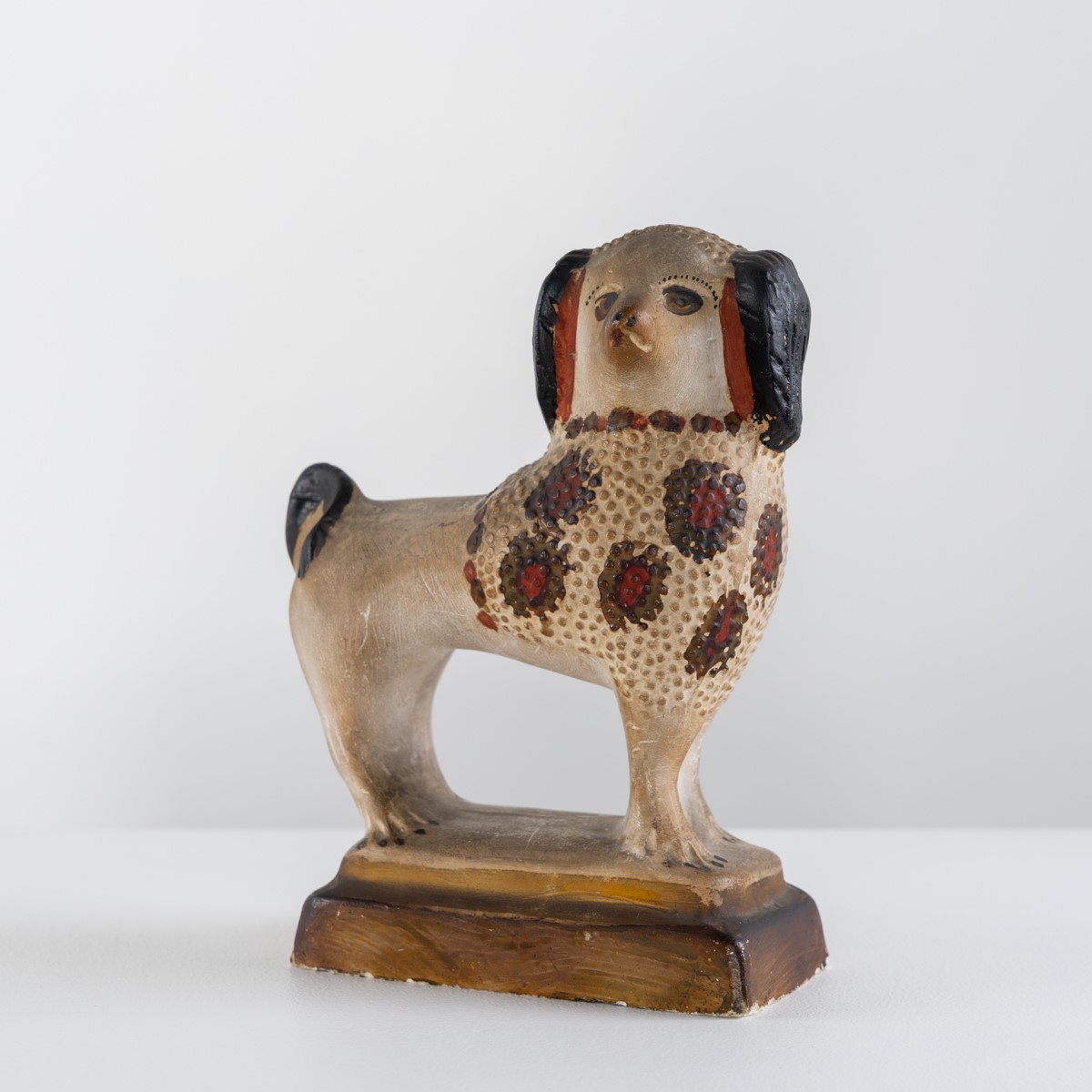 antique painted chalkware dog rel=