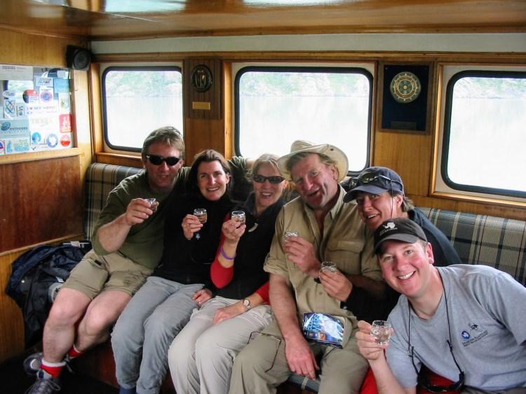 Active mature travelers celebrating.