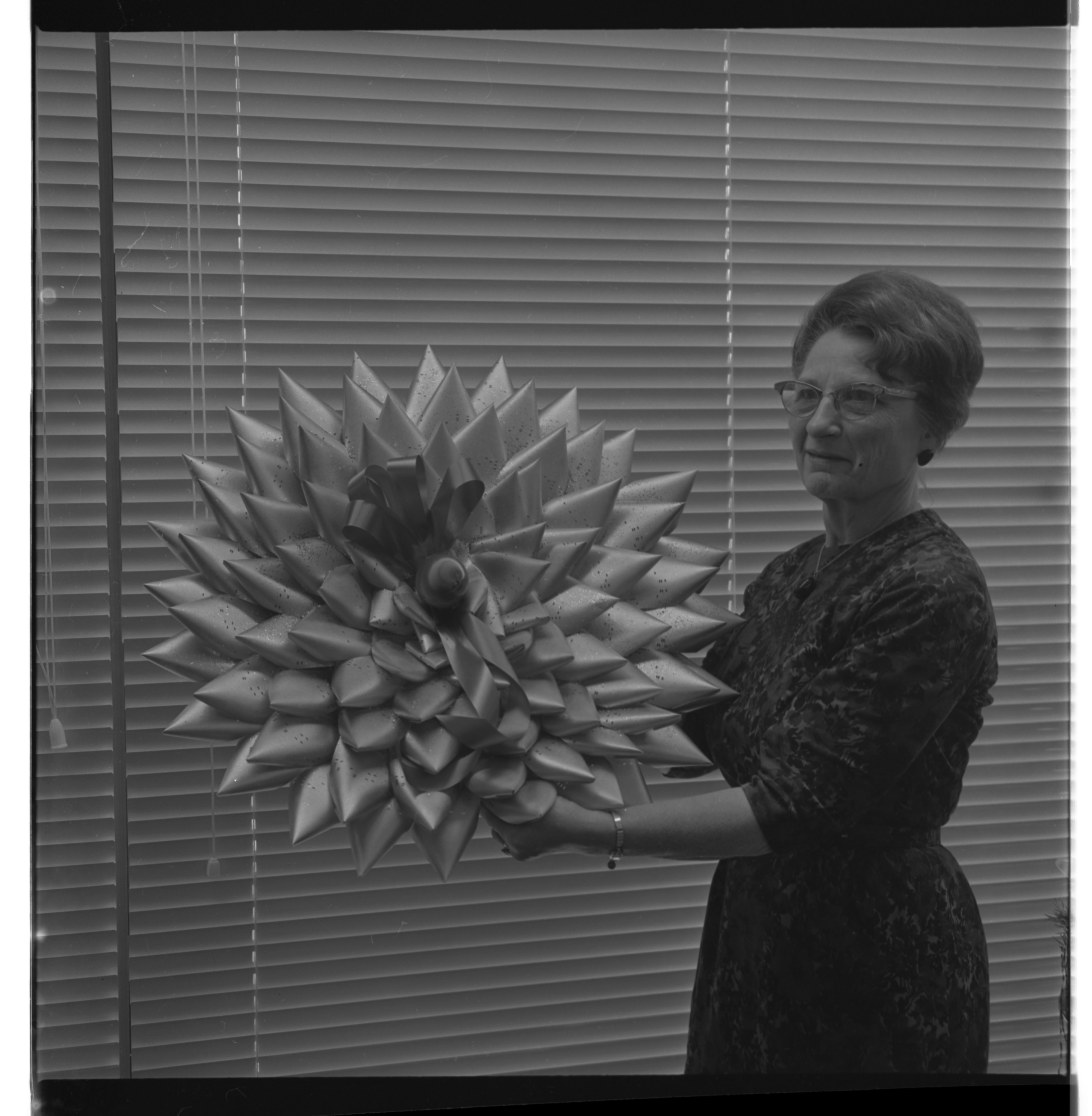 Margaret Beyer With Christmas Decorations Made From IBM