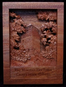pictorial relief scene of the Flagg mountain fire lookout tower in coosa county alabama carved from mahogany