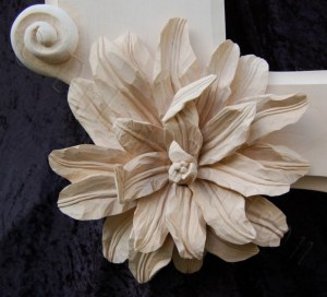 close up of one of the flowers on the corners of the ornate frame