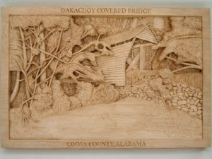 pictorial relief scene of Oakachoy Covered Bridge, carved by dylan goodson