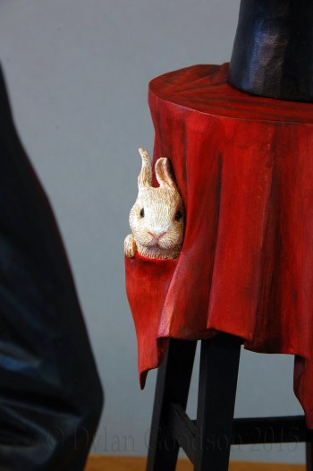 """The rabbit tucked in the secret pocket of the table cloth on Dylan Goodson's wood carving, """"The Magician""""."""