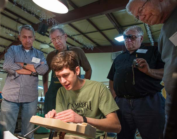 Dylan demonstrating for students during one of his woodcarving classes