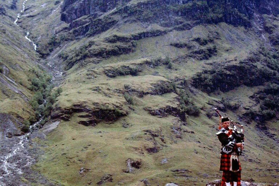 Scotland - Scotland-1979-06-Glencoe-Massacre-Site-Bagpipe-Player.jpg